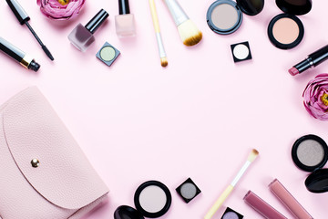 Make up products frame on a pastel pink background