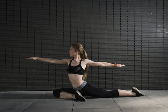 Flexible woman stretching muscles