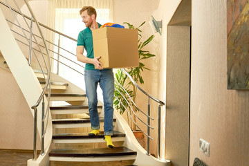 Caucasian man with cardboard box. Guy moving out.