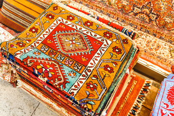 traditional handmade carpets with oriental ornaments and patterns for sale at the open market