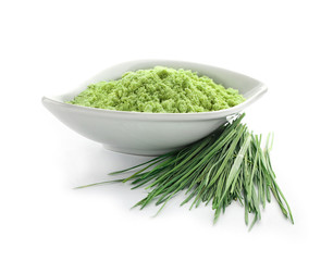 Bowl with wheat grass powder and sprouts, isolated on white