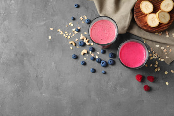 Glasses with berry protein shakes on table