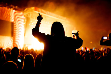 Girl with glass of beer enjoying the music festival, concert