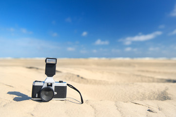 Photo camera at the beach