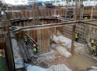 Building foundation work at the construction site. Heavy construction work.