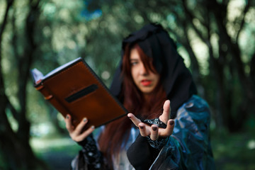 Witch with book in hood