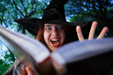 Close-up image of witch reading spells