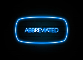 Abbreviated  - colorful Neon Sign on brickwall