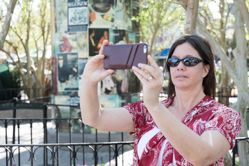 Woman taking picture with smart phone