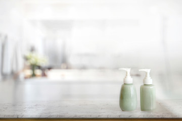 Ceramic Shampoo and Soap Bottle on marble counter and bathroom background.
