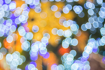 Abstract blue and purple bubble bokeh for Christmas background. Abstract defocused glitter background. Merry Christmas and happy new year concept.