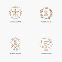 Set of four linear winner awards.