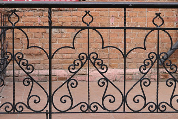 Wrought-iron fences and hedges
