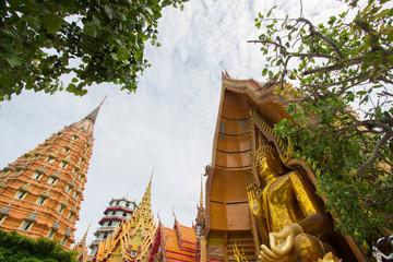 Octagonal pagoda,Chinese Pagoda,Vihara and large golden Buddha statue at Wat Tham Sua(Tiger Cave Temple),Tha Muang District,Kanchanaburi,Thailand.