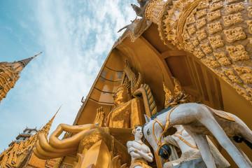 Octagonal pagoda and large golden Buddha statue at Wat Tham Sua(Tiger Cave Temple),Tha Muang District,Kanchanaburi,Thailand.