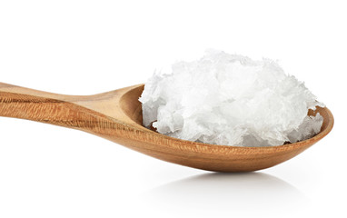 Wooden spoon with coconut oil isolated on white background.