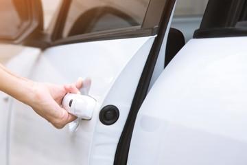 close up hand car open door