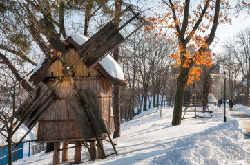 Windmills in a winter setting at the Village Museum 'Dimitrie Gusti' in Bucharest.