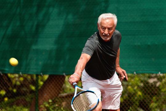Senior Man Playing Tennis