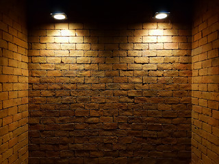 abstract old brick wall in the dark with two spotlight, warm light tone. brick wall in empty room. brick wall background for wallpaper