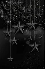 Cutout Black Foil paper Stars on dark Background.