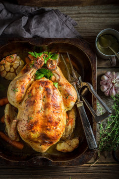 Tasty roasted chicken with spices and vegetables