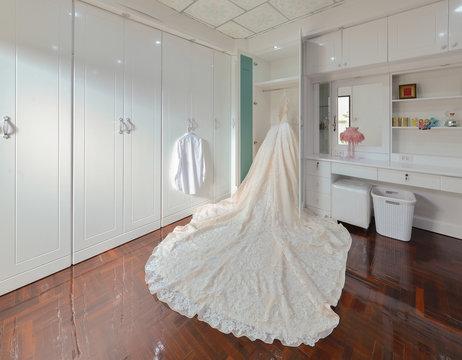 Bride wedding dress in a white room, interior design