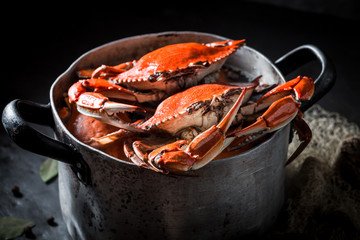 Ingredients for homemade crab in a old metal pot