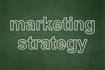 Advertising concept: Marketing Strategy on chalkboard background