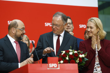 SPD leader Martin Schulz, Lower Saxony's state premier Stephan Weil and SPD politician Manuela Schwesig attend a meeting at the party headquarters after state election, in Berlin
