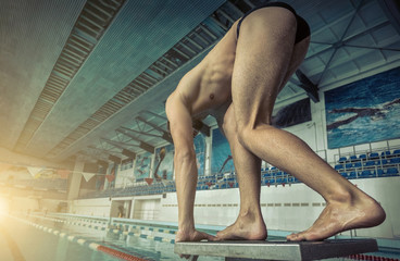 Swimmer man. Swimmings athlete after start jump to distance in w