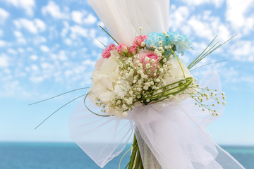 Delicious bouquet on the arch for cerimony at wedding.