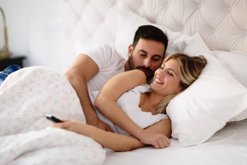 Happy couple enjoying their time in bed