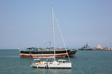 Luxury sailing boat, fishing and cargo ships at anchor in the port of Djibouti