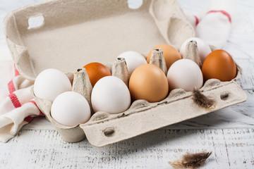 Hen eggs in a basket. Rustic style