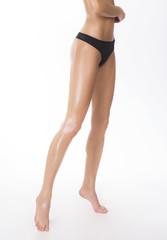 Clean white skin with no cellulite. Profile studio shot.