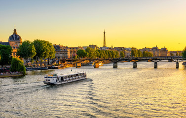 Sunset view of Eiffel tower, Pont des Arts and Seine river in Paris, France
