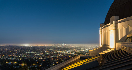 View to Los Angeles Downtown at night from Griffith Observatory. Beautiful panorama cityscape from tourist attraction.