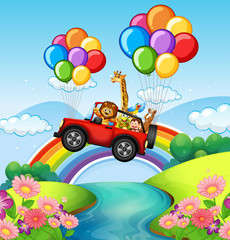 Wild animals riding on red jeep over river