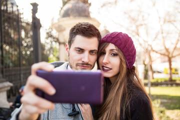 couple taking selfie in the street