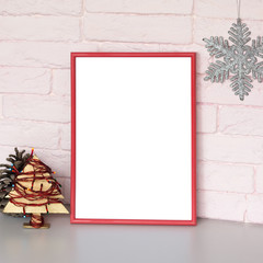 Mock-up poster in red frame. Blank canvas in the Christmas interior. Pink brick wall on background.