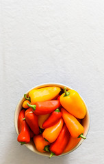 Vertical view of colorful peppers in bowl.