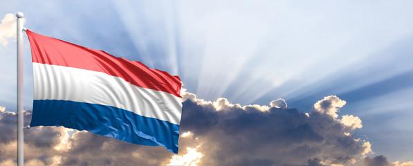 Netherlands flag on blue sky. 3d illustration