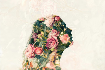 Double exposure of young woman and pink roses