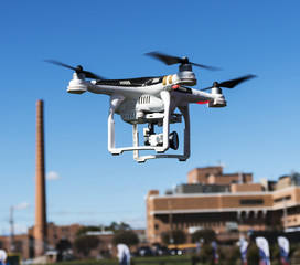 Drone flying low with hospital building in the background