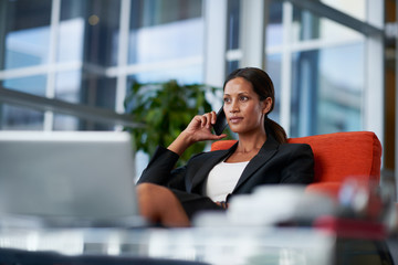 stylish businesswoman makes a business call on her mobile phone