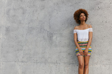 Latin American Afro Woman Against a Concrete Background