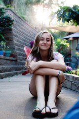 Beautiful smiling teenage girl on the patio as the sun goes down