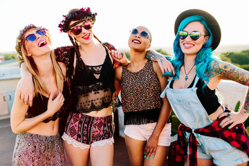 A group of girls laughing & enjoying the nice summer weather.