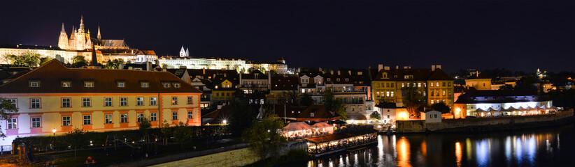 Prague, Czech Republic - October 10, 2017: Beautiful evening view on Dvorak embankment, Saint Vitus Cathedral, Vltava river and old town of Prague. Panorama of Prague city center, Czech Republic.